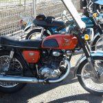 A half restored 1968 Honda CB250 showing the restored side