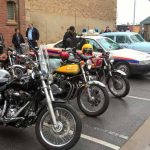 Historic Police cars and entrant's bikes.
